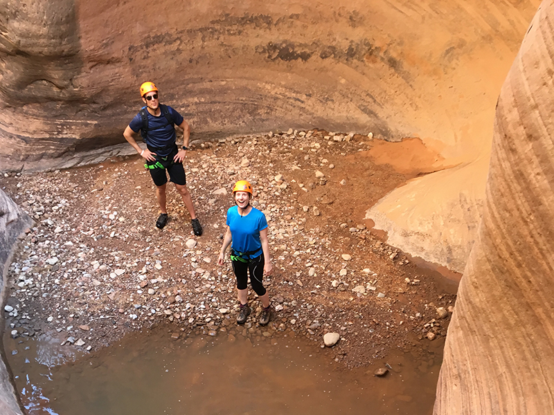 two people in a canyon looking up