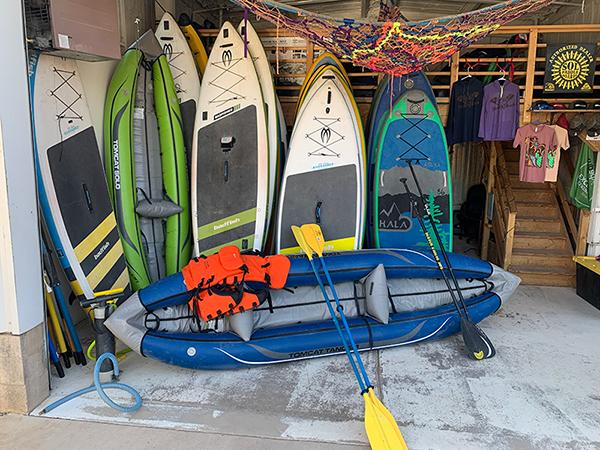Paddle boards lined up inside shop