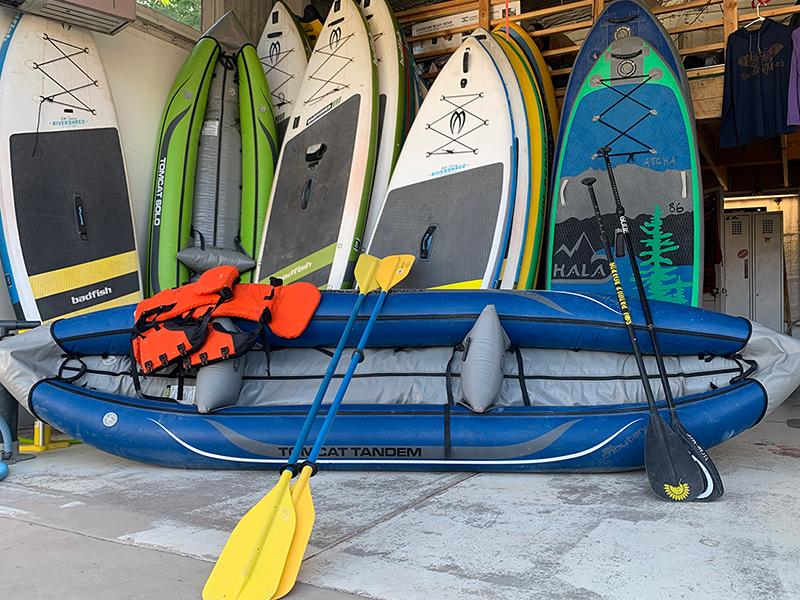 kayak in front of boards inside shop