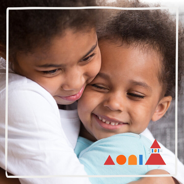 Two kids hug at Hope Street Friends KinderCare