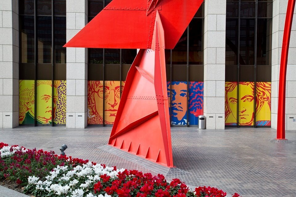 Four Arches sculpture by Alexander Calder with Signs of Life vinyl installation by John Van Hamersveld at Bank of America Plaza Courtesy of Charles Lenoir