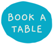 A blue circular button that says 'Book a table' which links through to a booking form