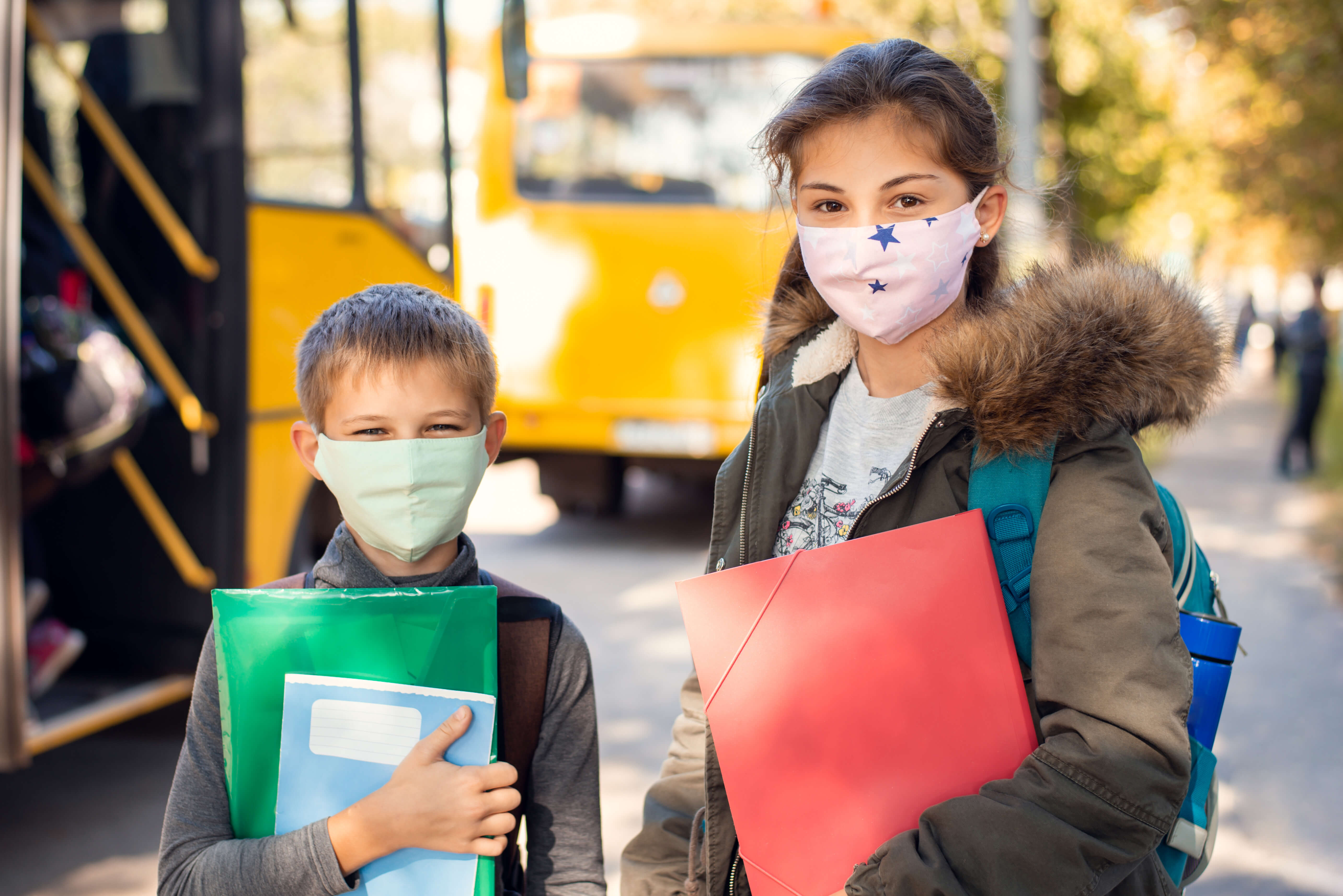 Kids in masks learning at school.