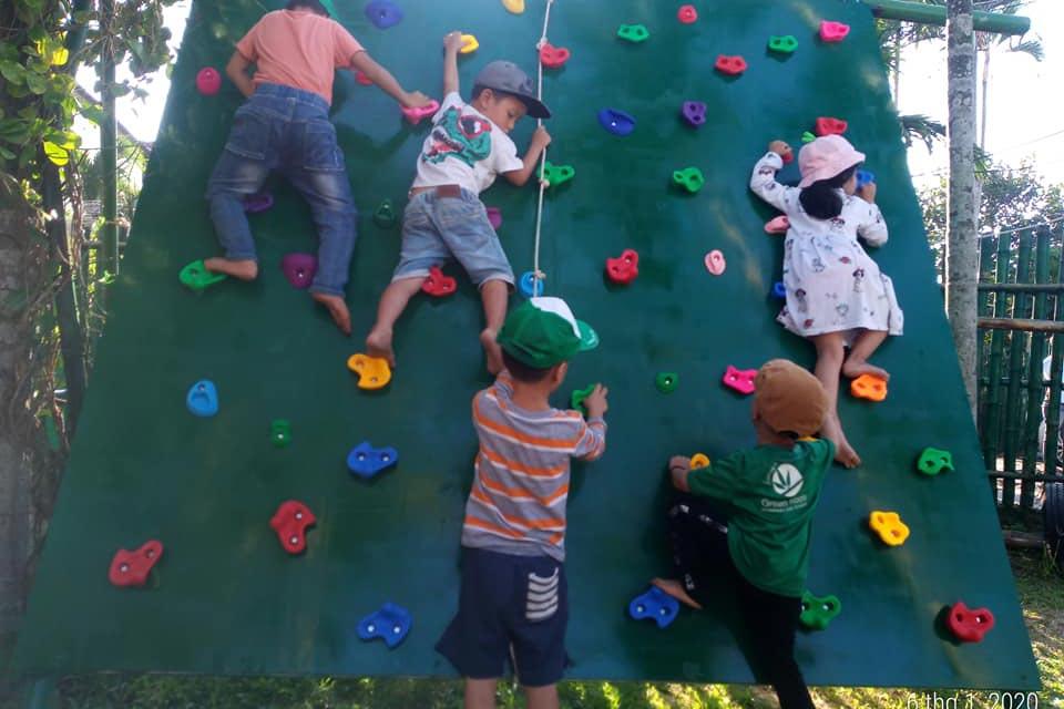 Children climbing at Green shoots international school