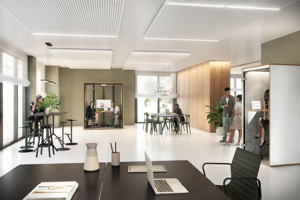 Ein minimalistisches Büro mit Telefonkabine und Raum in Raum System für ungestörte Telefonate und Meetings.