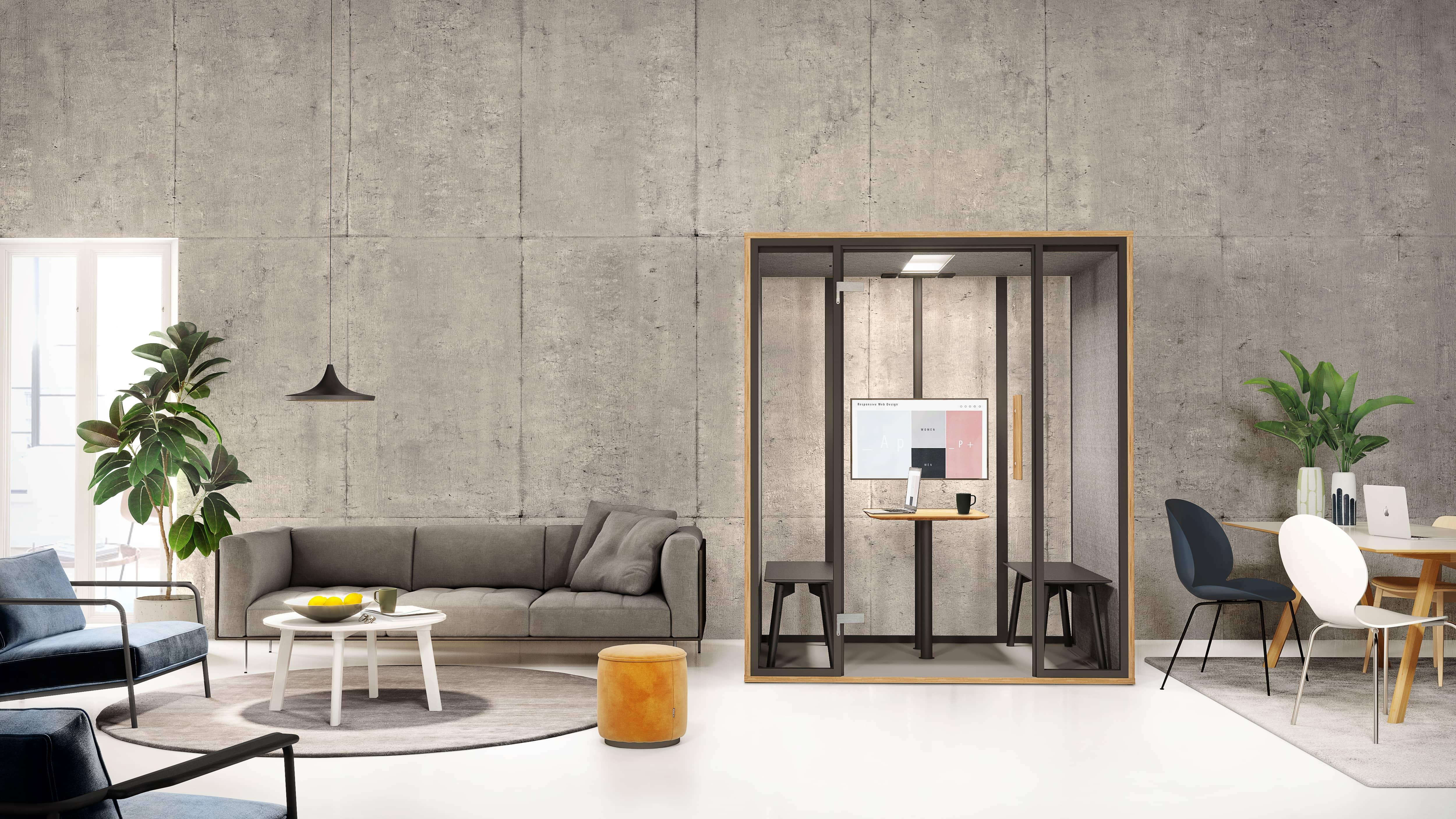 Eine leers Büro mit Stühlen, Sofa und einem Raum in Raum System.