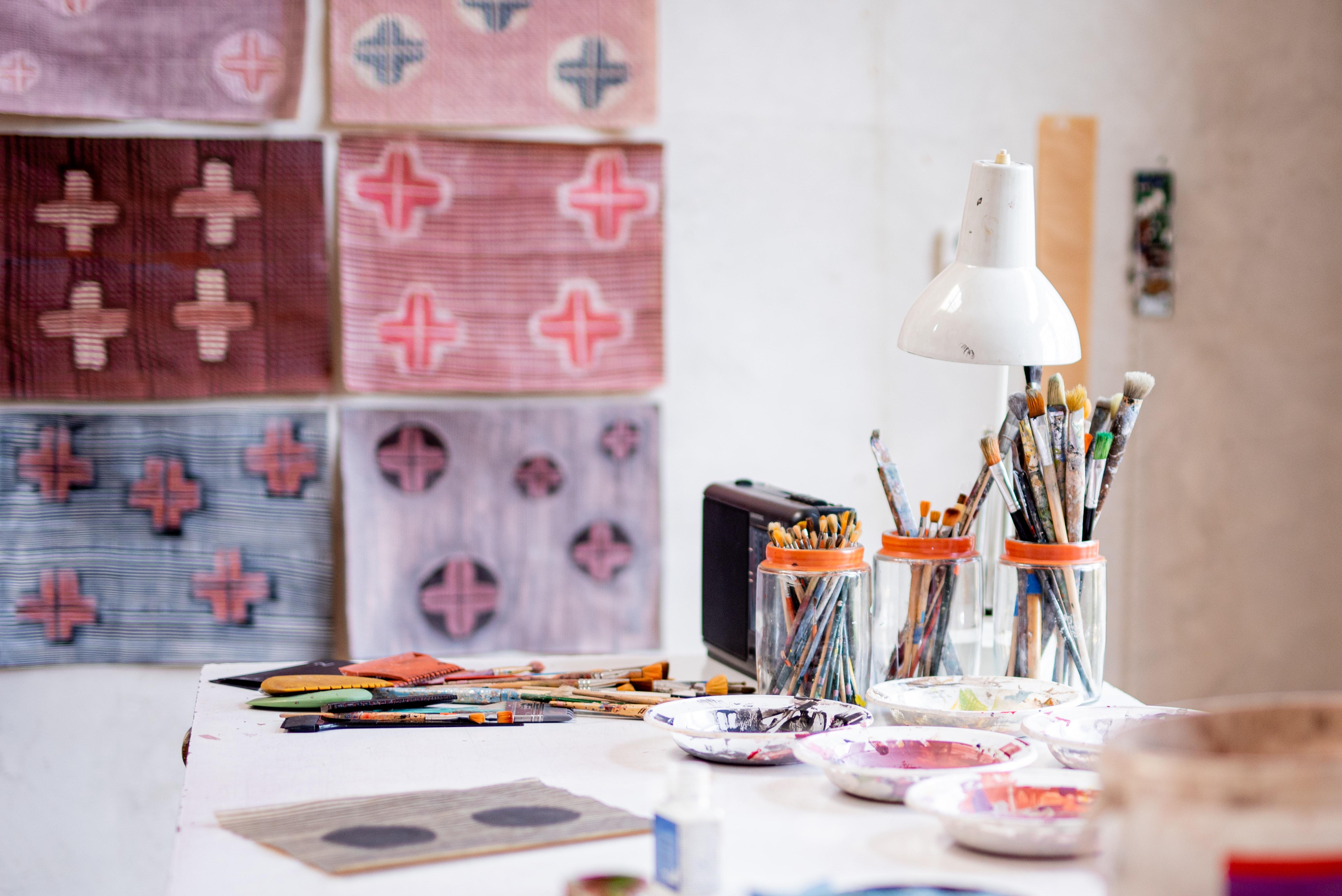 Visual art studio set-up in college dorm room.