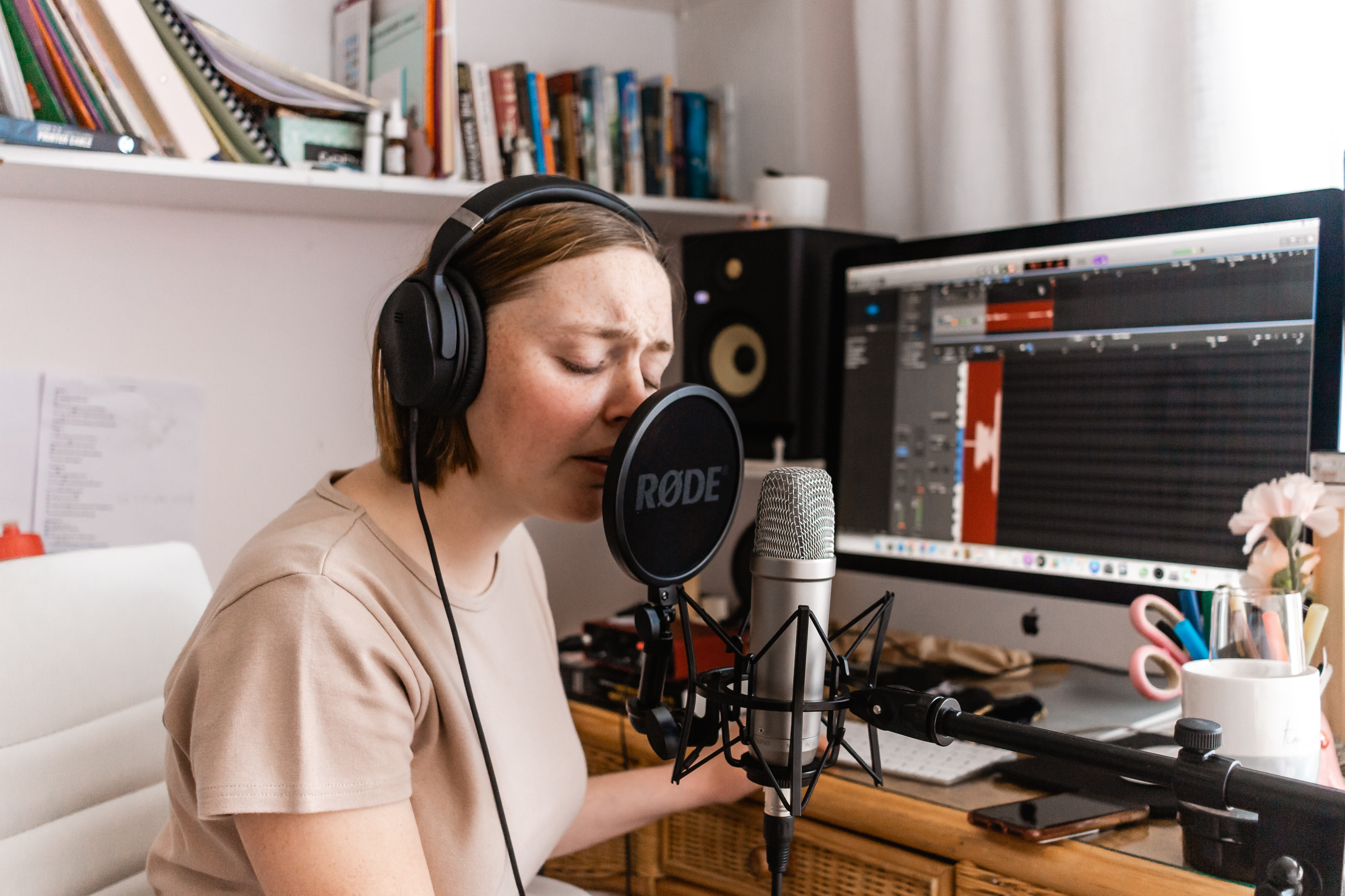College student recording music in her dorm room