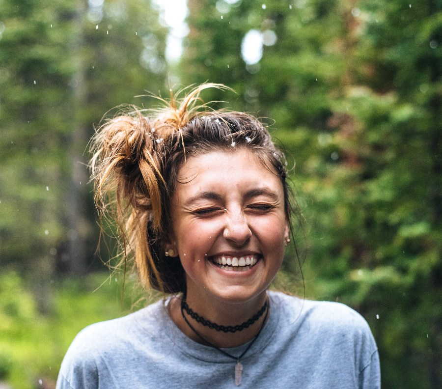 a woman smiling in nature