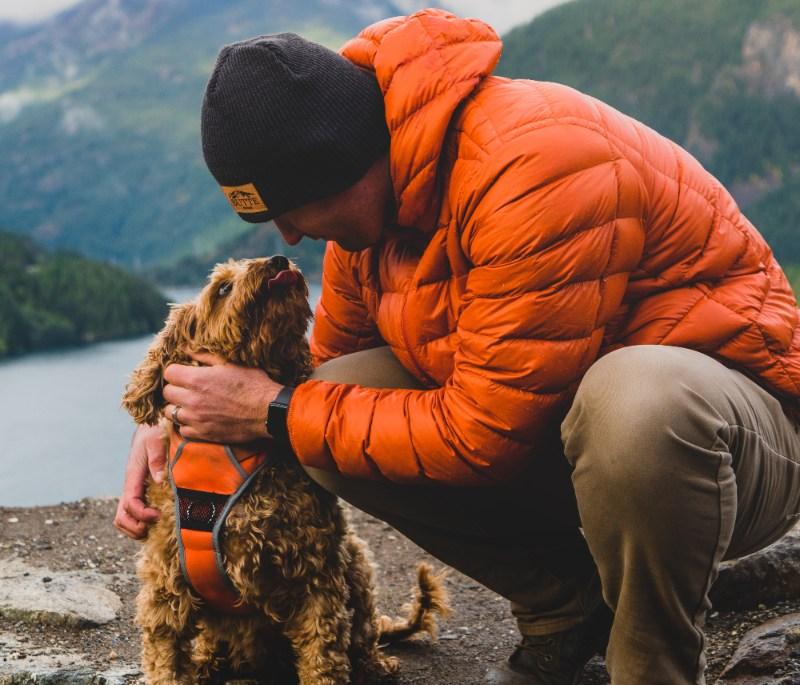 a man and dog on a hike