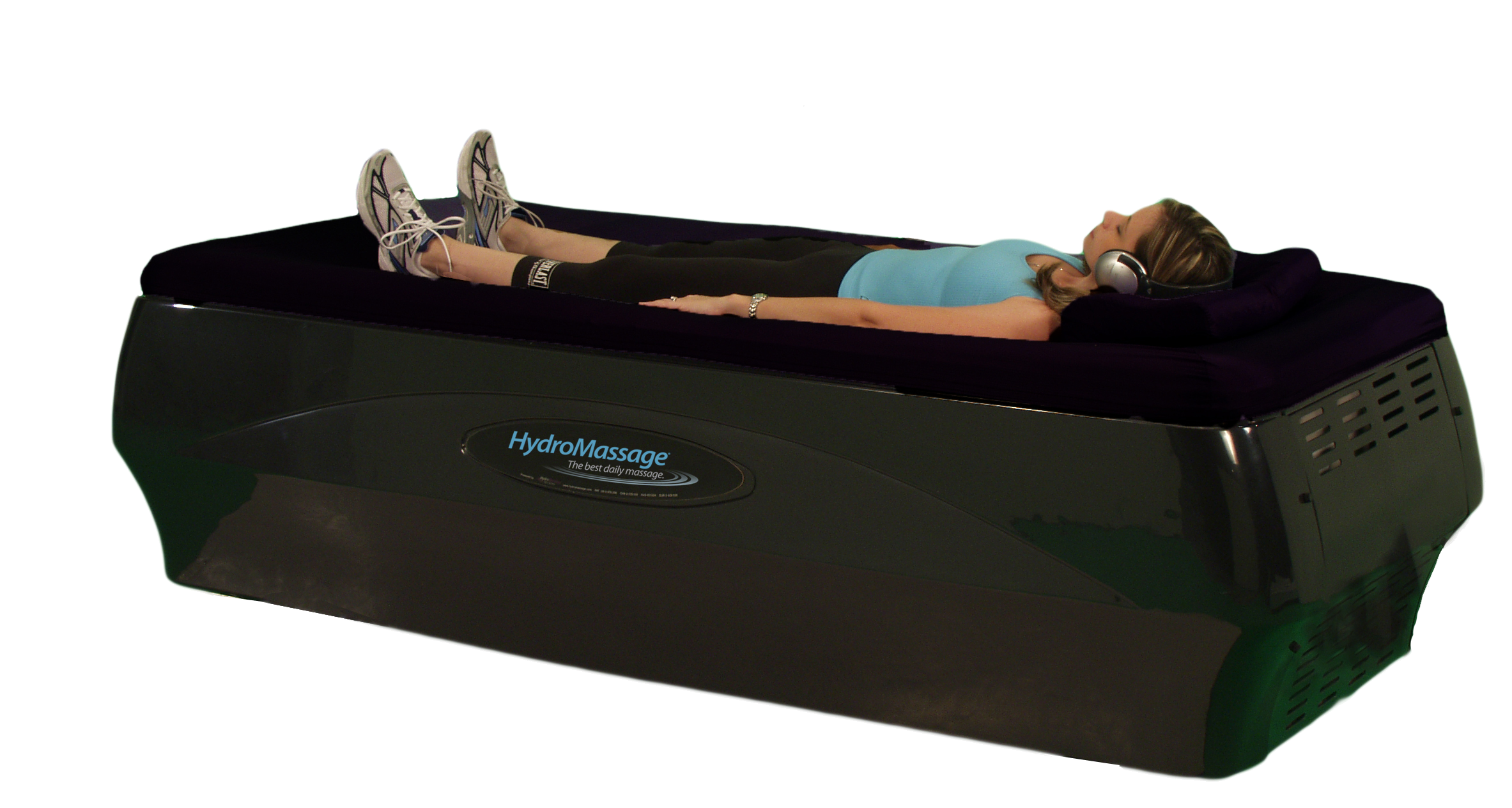 women in exercise clothes lying on hydromassage table