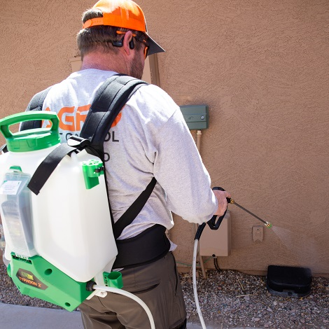 Agro Employee treating for bugs in Phoenix Arizona.