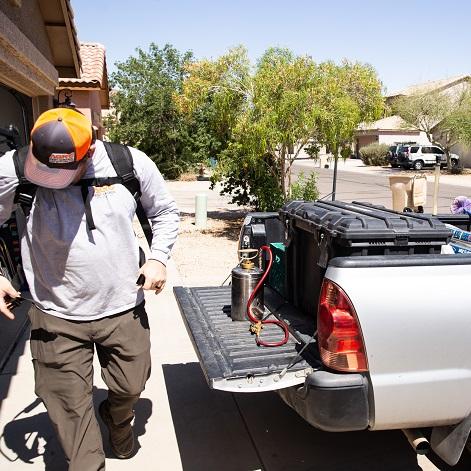 Agro Employee preparing to do pest control in Phoenix, AZ.