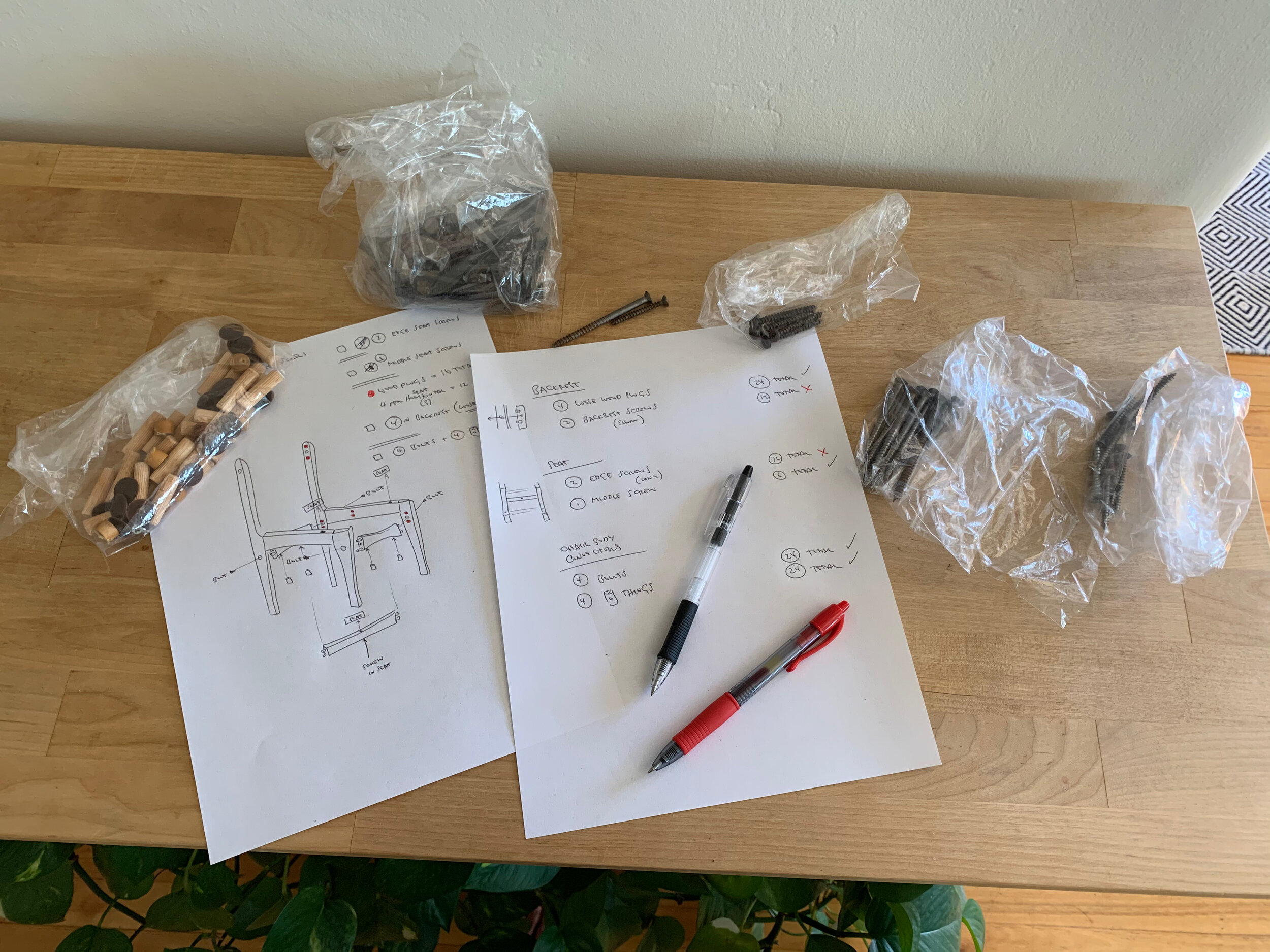 Photo showing screws in plastic bags and a sketch of the chair construction