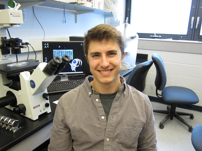 Photo of young Joe in a microscopy laboratory