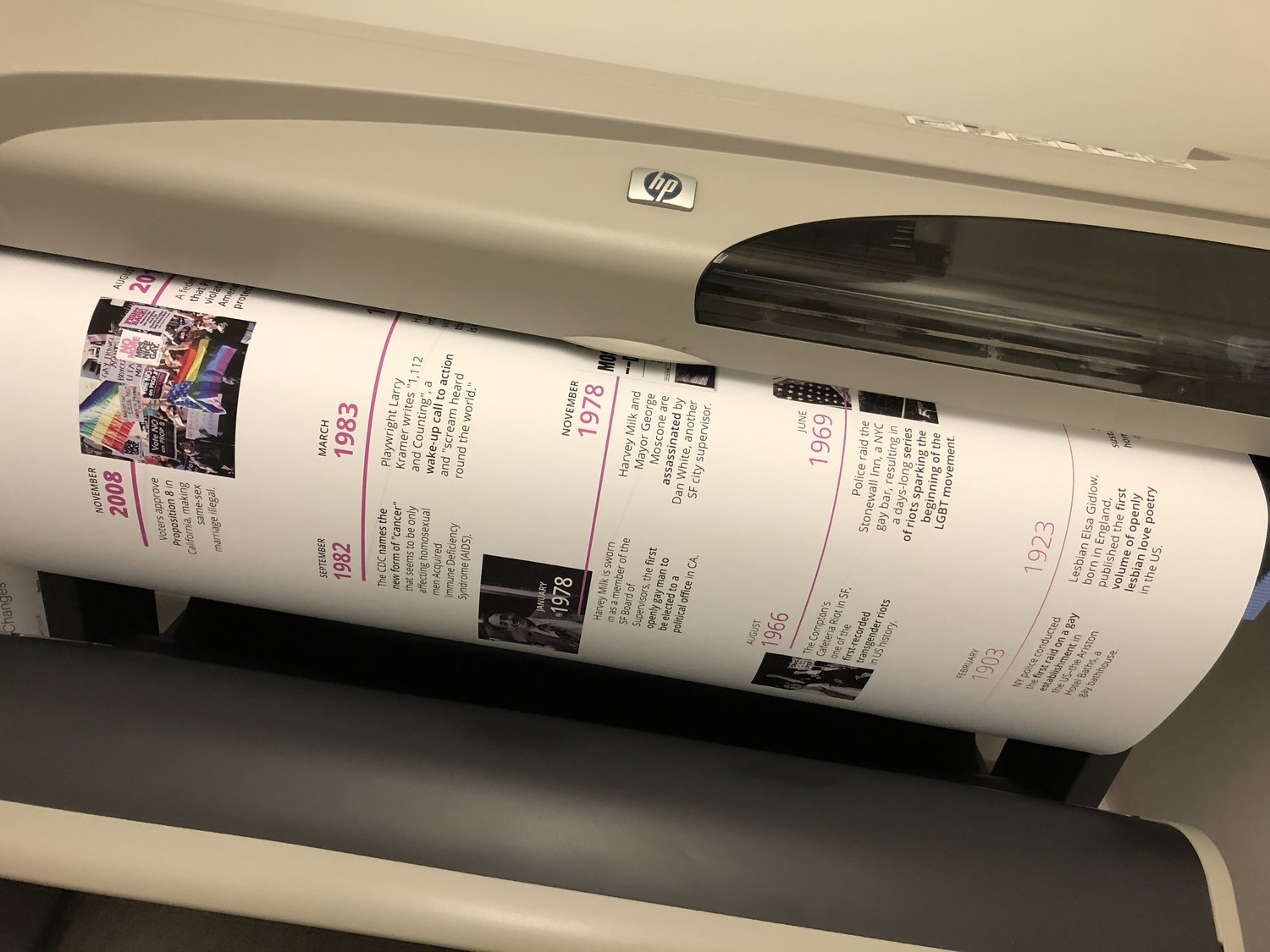 Printing the 42 x 80 inch LGBT timeline on our studio Plotter.