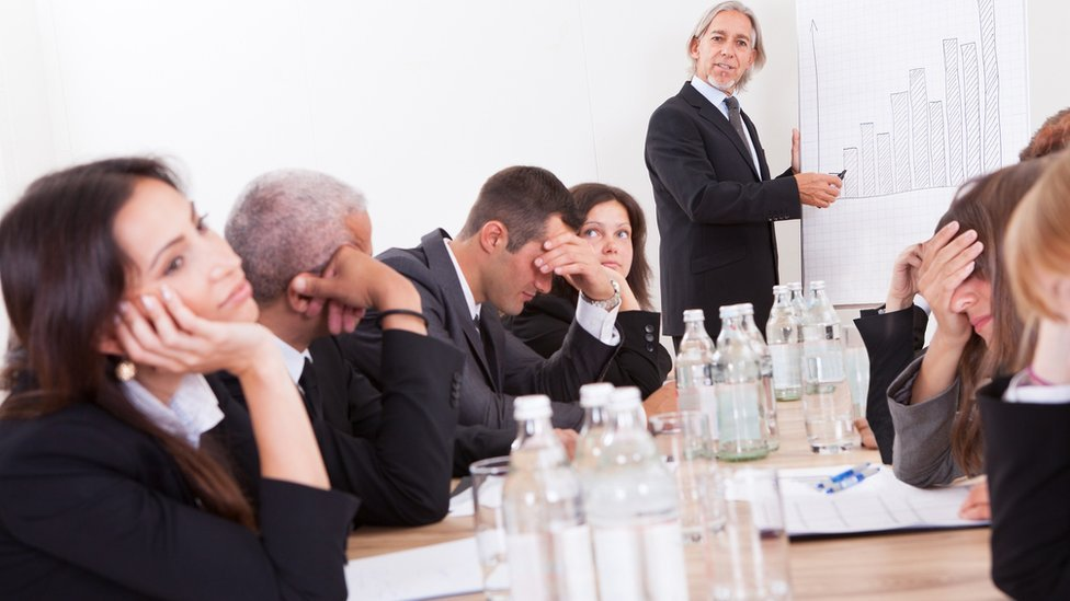 Employees looking bored in a meeting