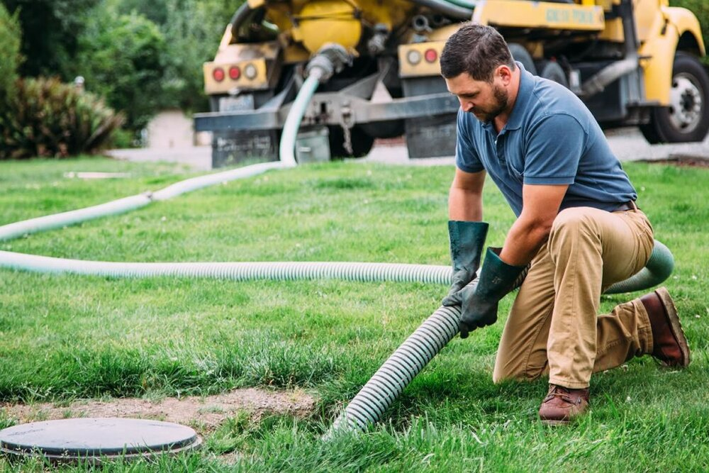 Guy pumping a septic tank