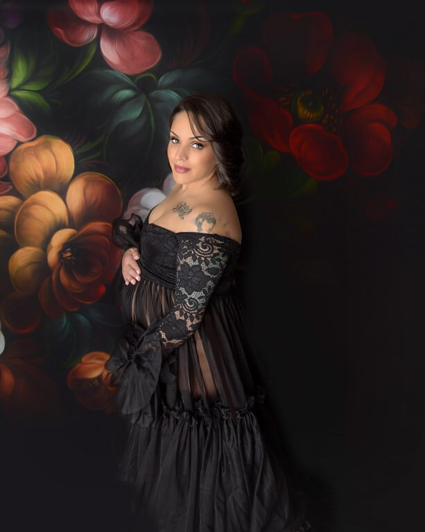 Photograph of pregnant mother in black dress with flower background
