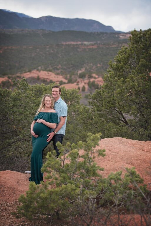 Photograph of male and female couple in nature, woman is pregnant