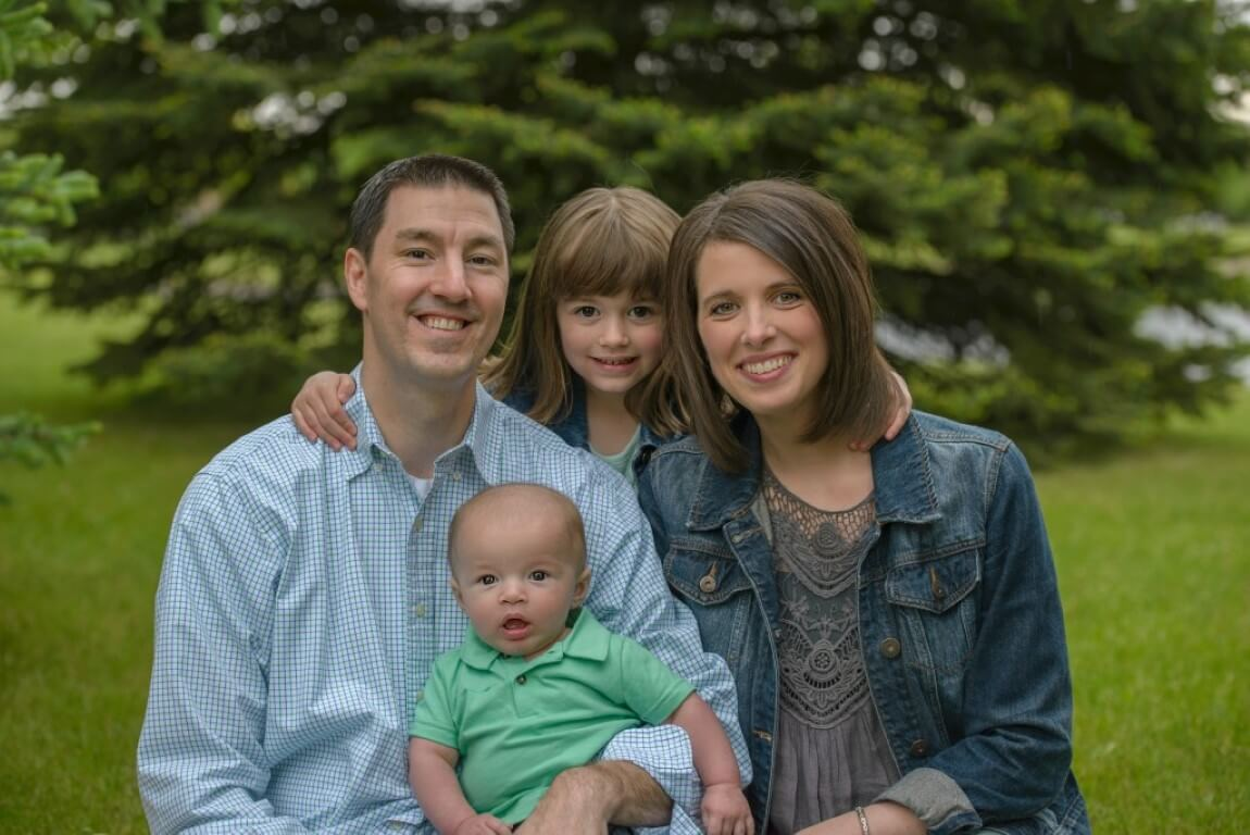 Close up photograph of a family of four including a baby