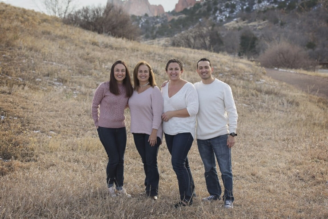 Family Photograph of 4 people set in nature