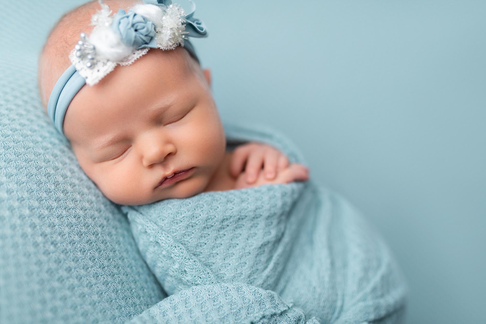 A sleeping newborn baby