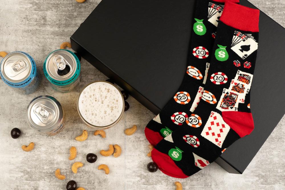 Beer and nuts gift box flat lay.