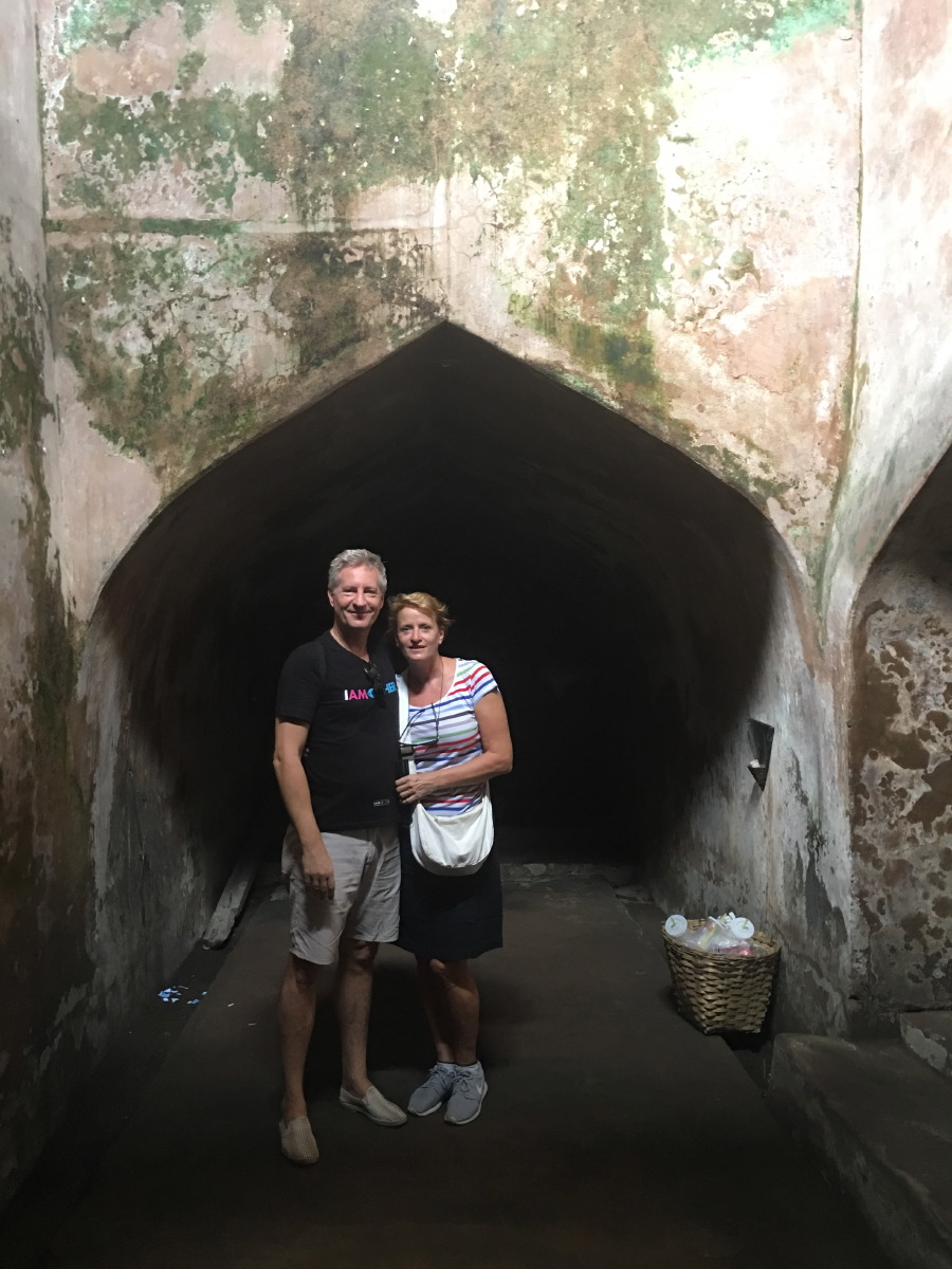 In the underground tunnel that leads to the well.