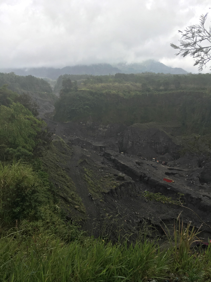 We never saw the top of the mountain this day, but we were in awe of this trough which was formed by pyroclastic flows when Merapi erupted in 2010.