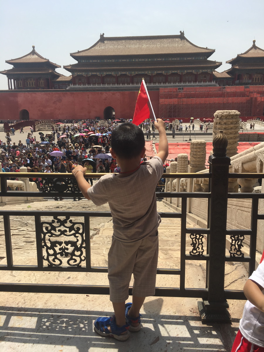 Forbidden City. Cheering on his people, this little emperor.....