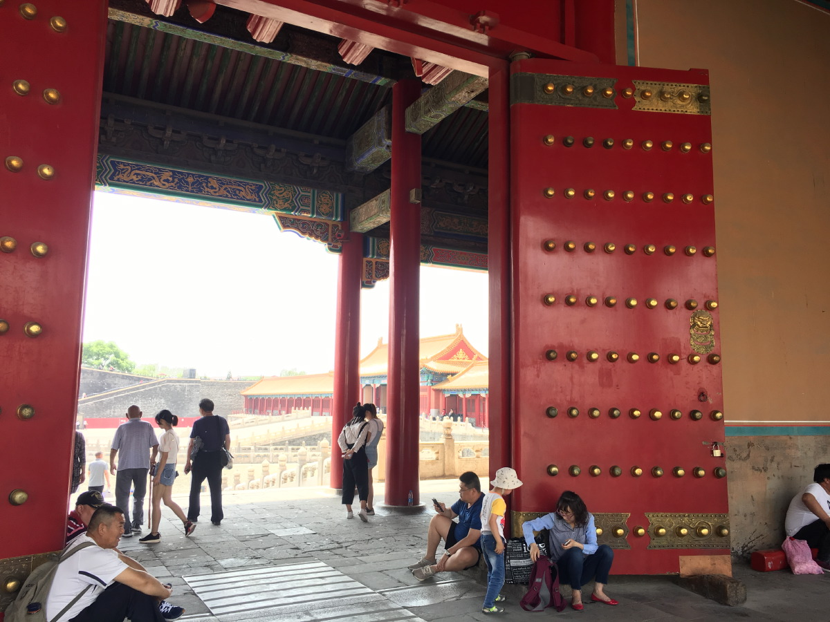 Stunning doors on the Gate of Supreme Harmony. Touching the brass knobs brings fortune. And dirty hands.