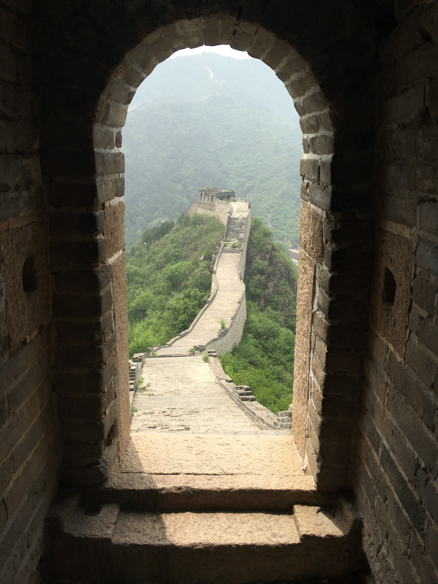 The Great Wall at Huanghuacheng is partly restored, but very steep. That is probably why most tourists go to Badaling where they can stroll easily. This was quite a climb!