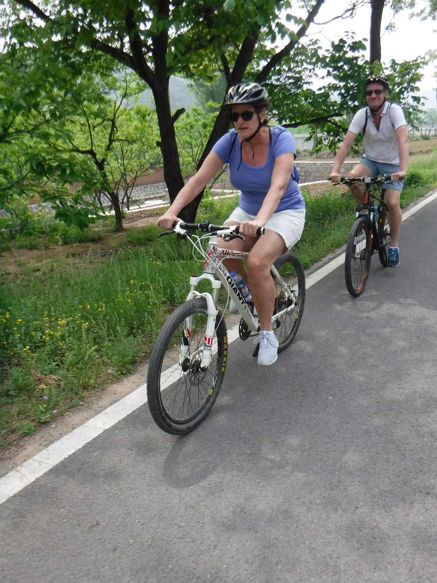 From Beijing to Huanghuacheng. We didn't want to go to the crowded places where you can see the Great Wall, so we booked a tour with Bike Beijing. After 45 minutes by car, we cycled another 15 km to the wall.