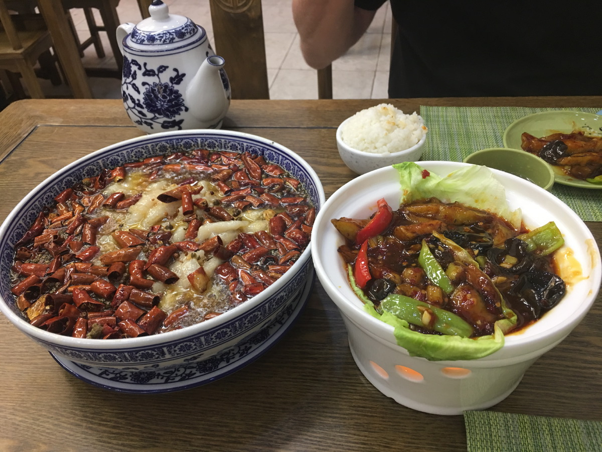 Last evening in Beijing. We just started walking to find a nice place to eat. We can't remember the name of this place (or couldn't decipher it) but boy oh boy, the food was fantastic. Luckily, they had a picture menu....