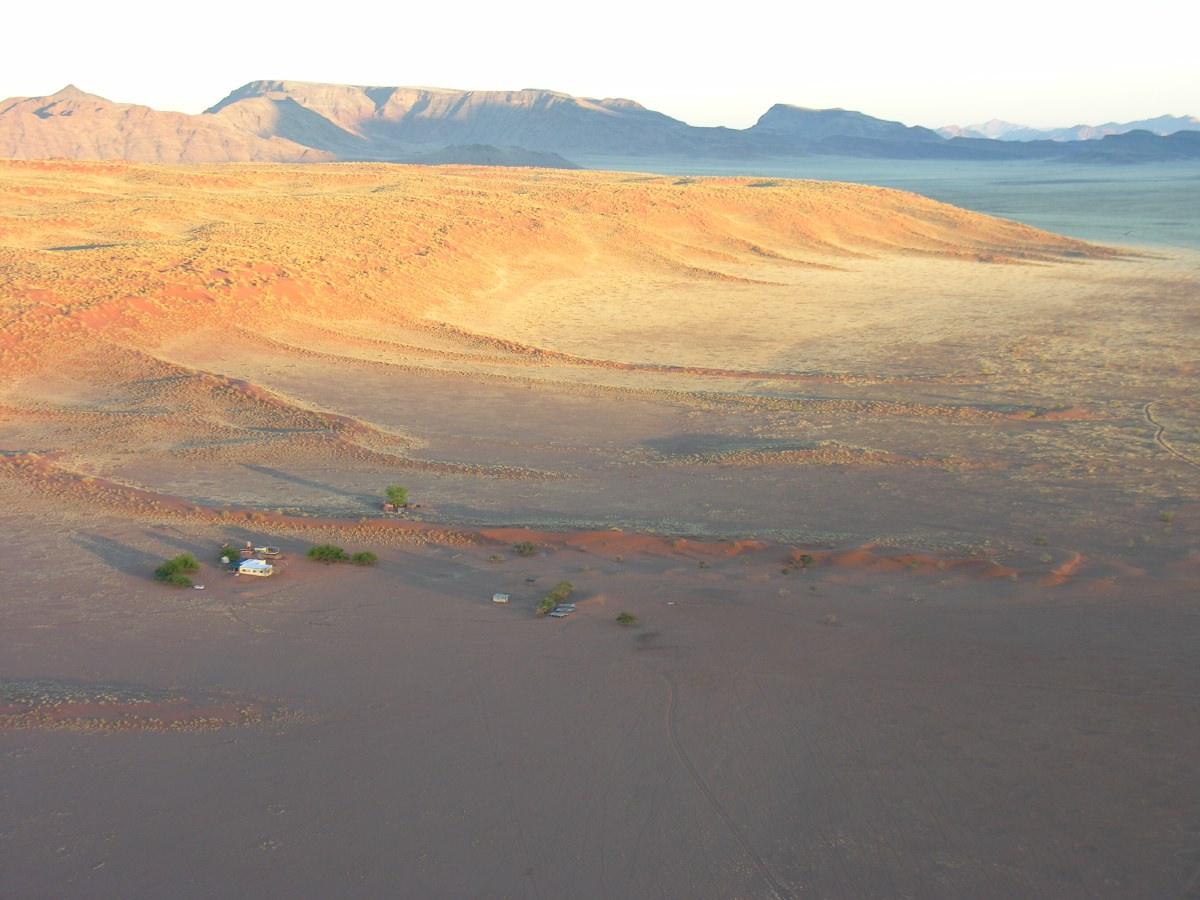 The edge of the orange sand dunes