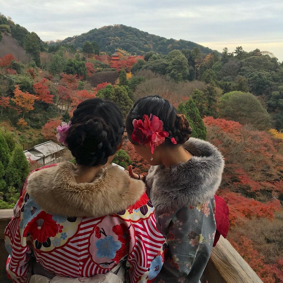 Kimono girls looking at the distant Koyasu Pagoda