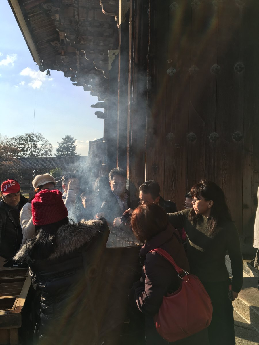 Incense burning at the temple entrance