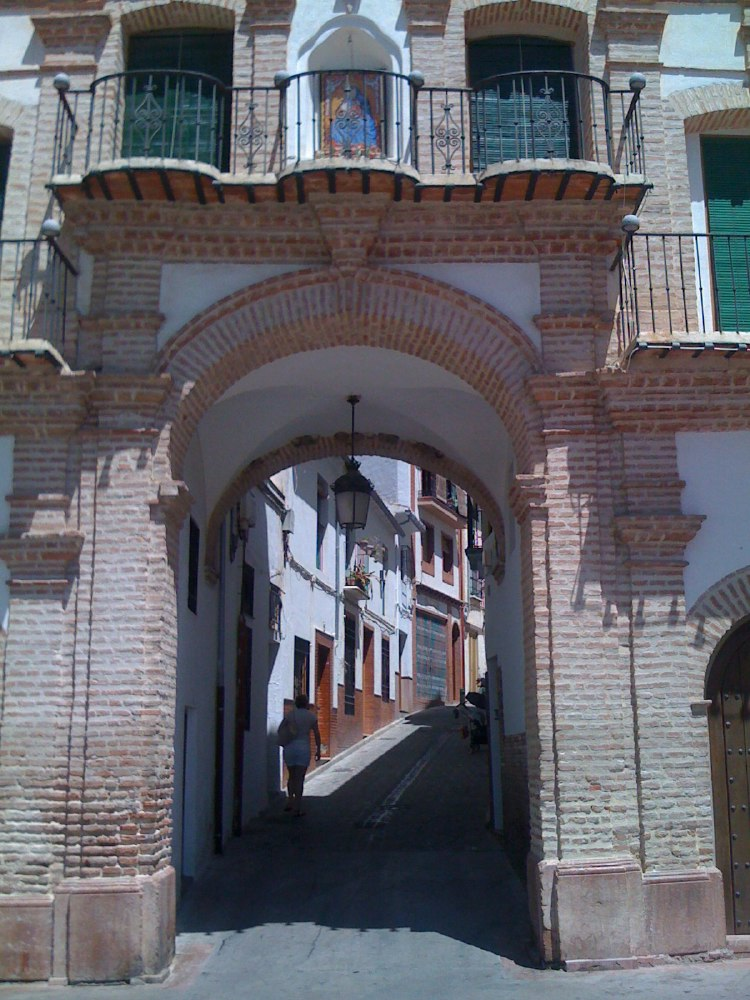 One of the arches leading to the octagonal square in Archidona.