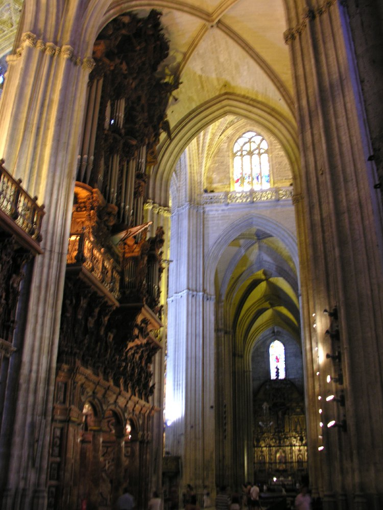 Sevilla cathedral was built from 1401–1519 after the Reconquista on the former site of the city's mosque. It is amongst the largest of all medieval and Gothic cathedrals, in terms of both area and volume. The interior is the longest nave in Spain.