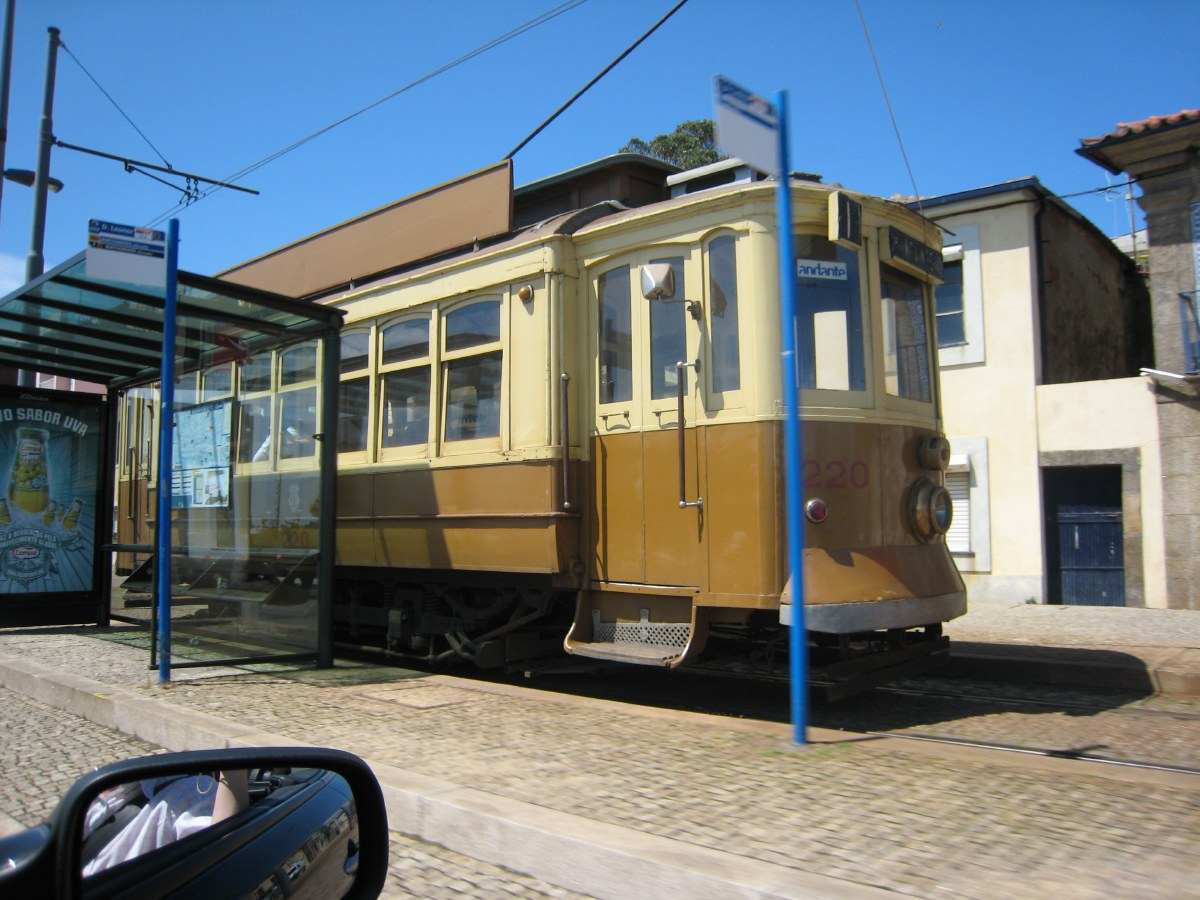 Antique street cars squeak along the banks of the Douro.