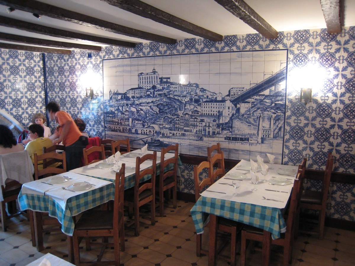 Inside the restaurant's upper room, the walls are completely covered with the famous blue and white tiles called azulejos.