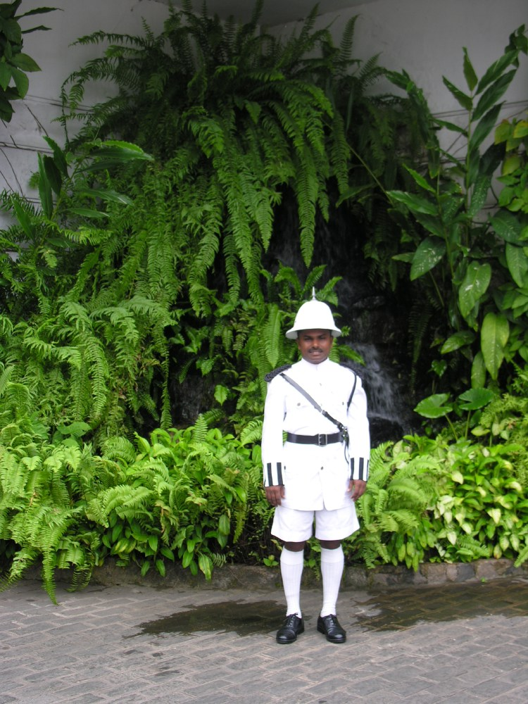 Mount Lavinia Hotel guard. This guy looks smaller than he really is. The funny costume plays tricks with the eyes...
