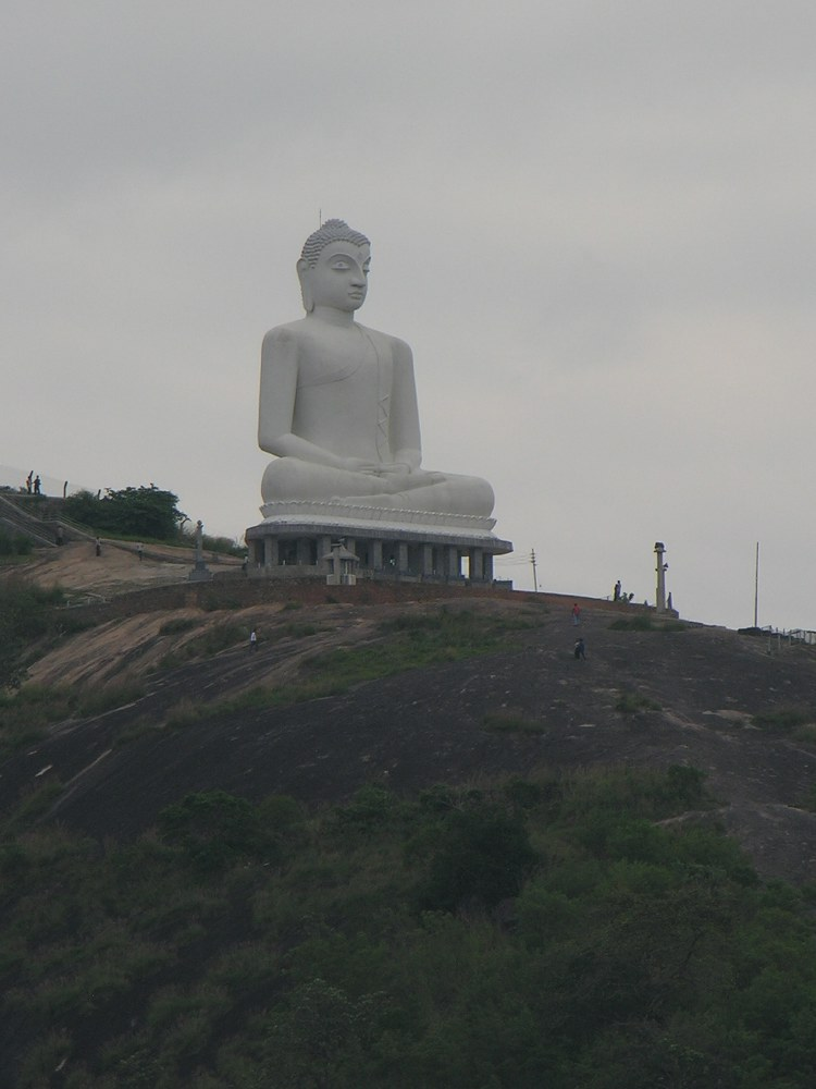 Modern boeddha statue on a hill