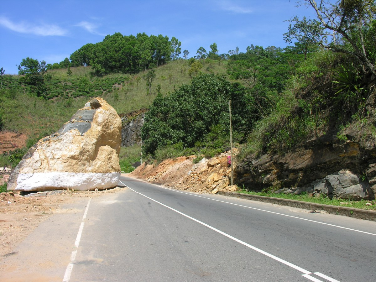Part of a mountain came crashing down sometime in the past. It's too expensive to clear it away, so it just sits there. No signs, no detours. Happy cruisin'!