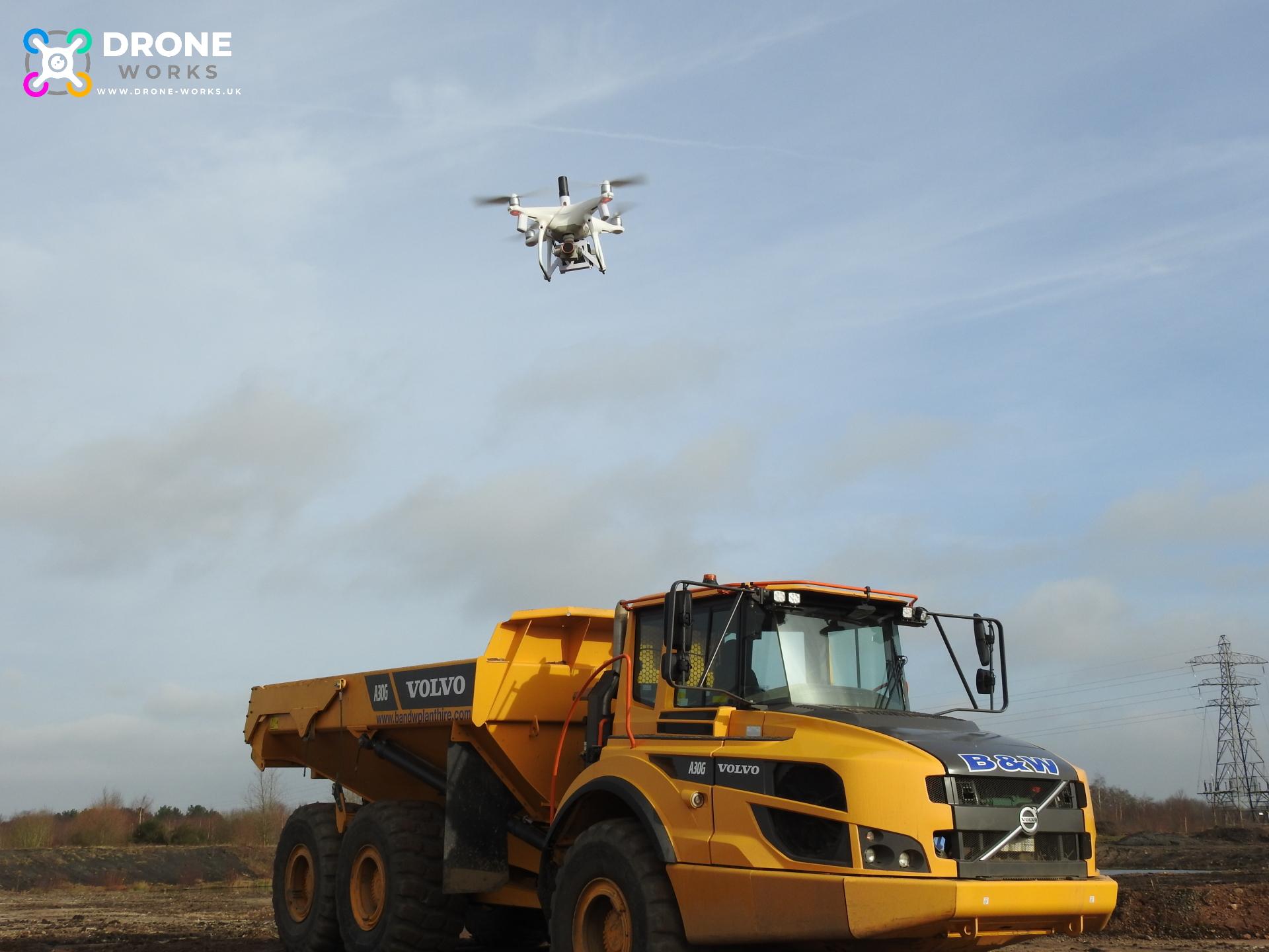 Phantom 4 PPK above a hauler on site