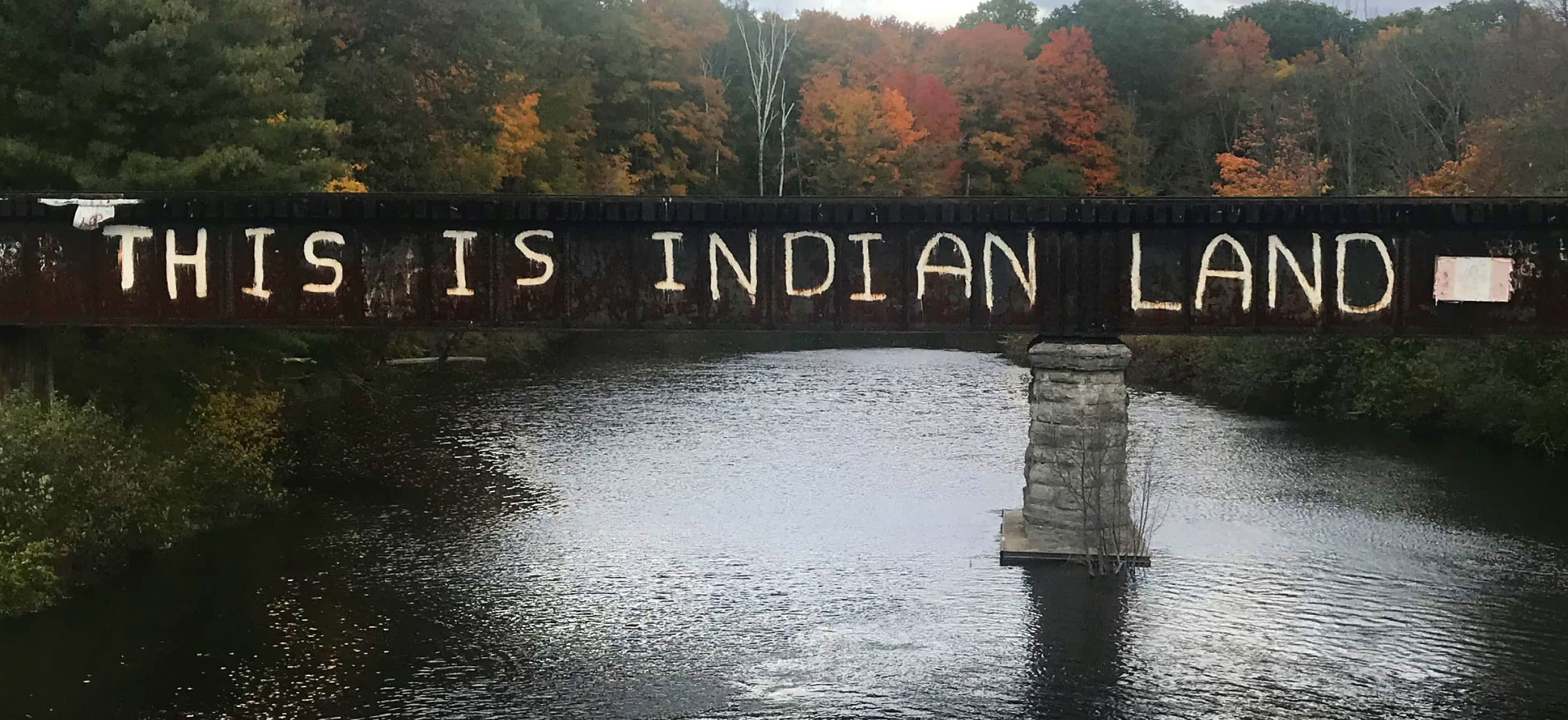 A bridge with this is Indian land graffiti