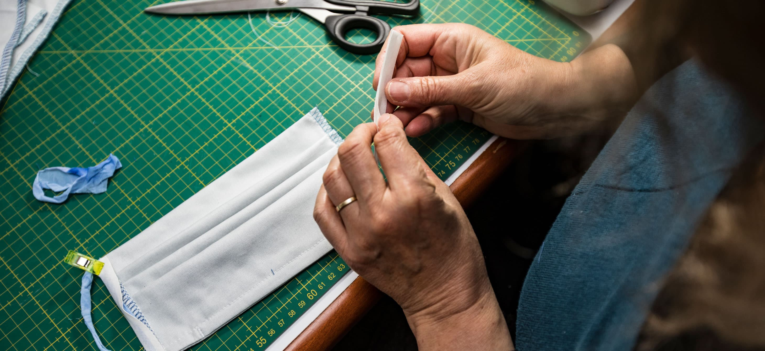 hands crafting a mask