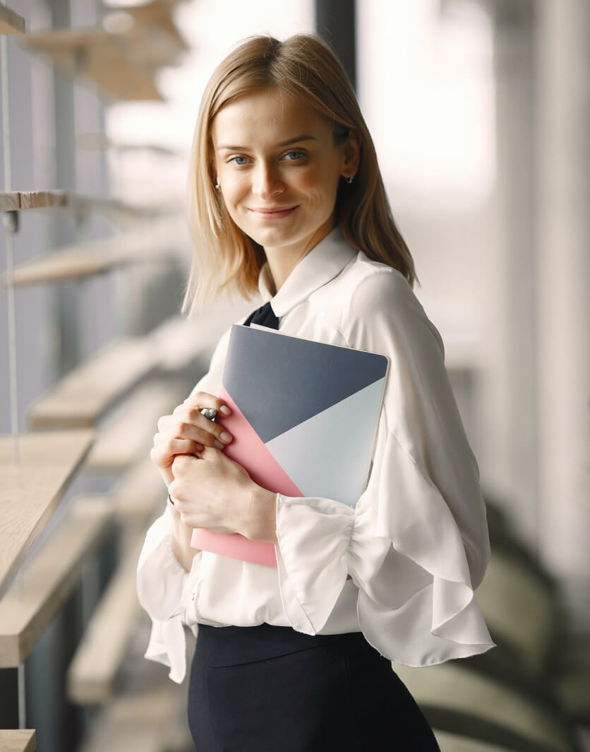 Smiling businesswoman holding her noetbook