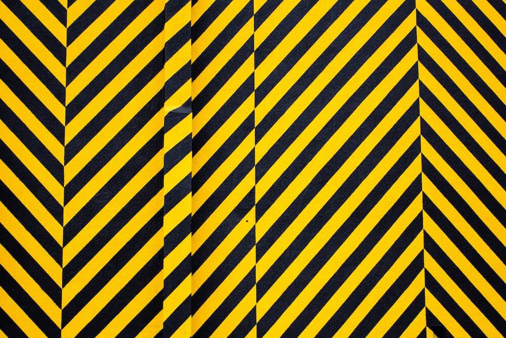 Black and yellow construction warning tape